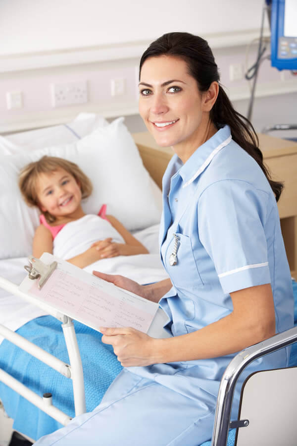 child and nurse in hospital ward